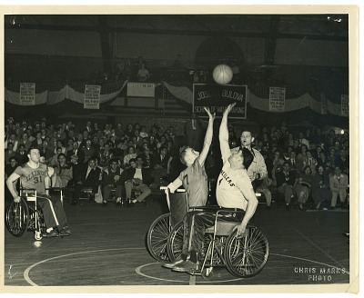 Photograph of Ray Werner and the wheelchair basketball team, The Jersey Wheelers, during a game