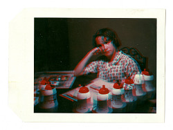 3D photograph of woman seated at table
