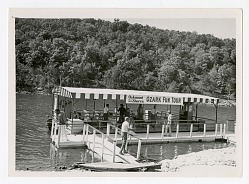 """river boat with """"Ozark Fun Tour"""" sign on side"""