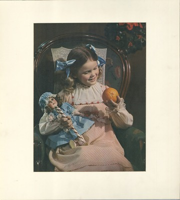 Little girl with orange and doll