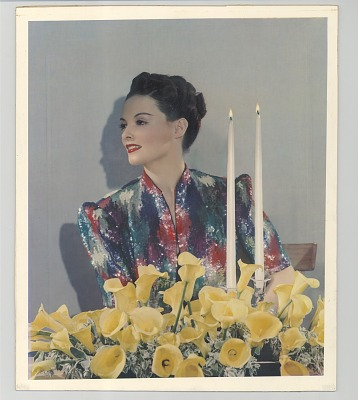 Woman with two candles and yellow flowers