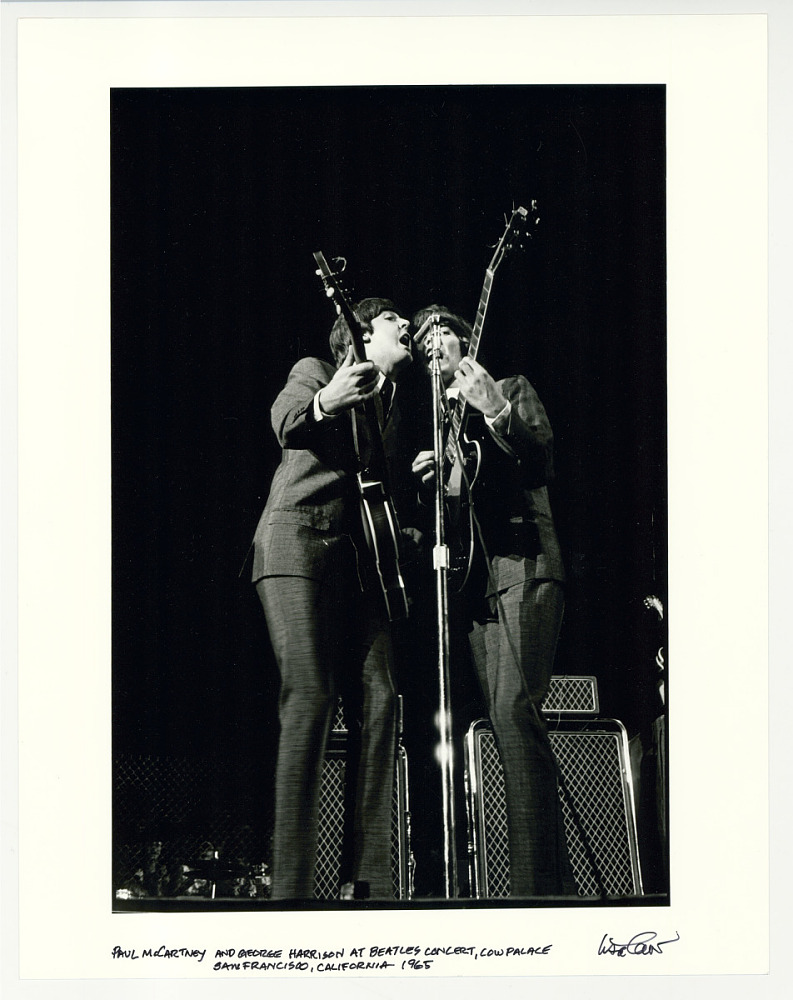 Paul McCartney and George Harrison at the Beatles concert, Cow Palace, San Francisco, CA. 1965