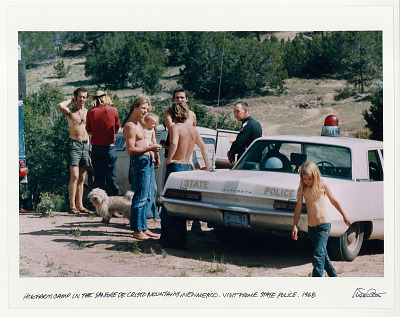 Hog Farm Camp in the Sangre de Cristo Mountains, New Mexico. Visit from the state police. 1968.