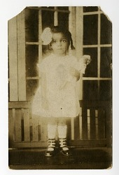 African American girl with doll