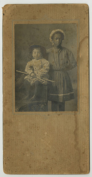 Young African American Nanny with Caucasian Boy