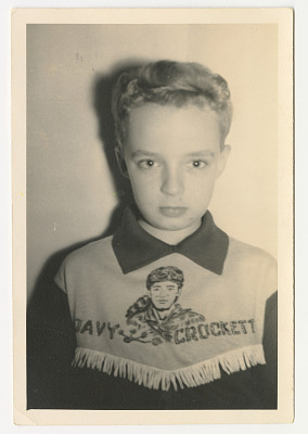 Young boy wearing a Davy Crockett shirt
