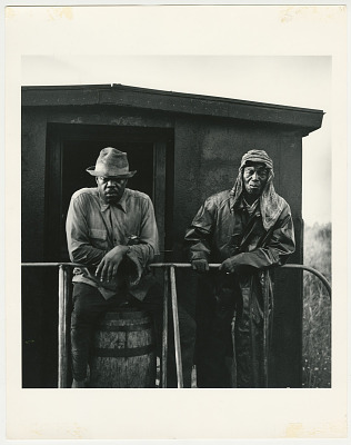 Two men on back of train