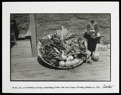 Young Child with Basket of Vegetables