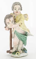 Meissen figure of a child wigmaker