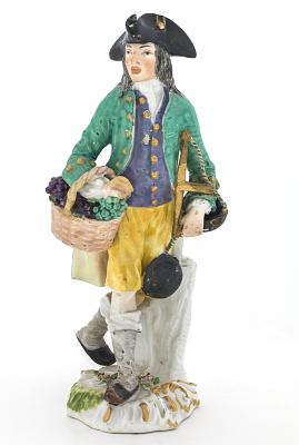 Meissen figure of a grape seller