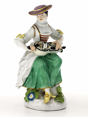 Meissen figure of a woman playing the hurdy-gurdy