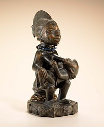 Female figure with child