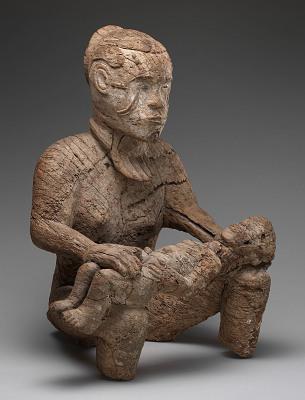 Female figure, fragment of a slit gong