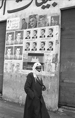 Portraits of the late Egyptian President Gamal Abdel Nasser plastered on wall building. Cairo, Egypt, [negative]