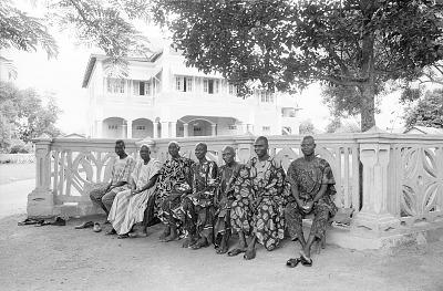 Yoruba men sitting outside the Oni's palace, Ife, Nigeria, [negative]