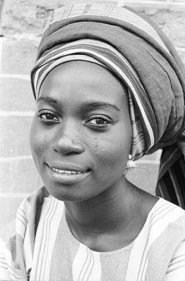 Yoruba woman wearing headtie of her own creation, Ife, Nigeria, [negative]