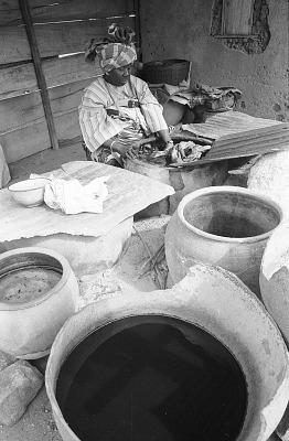 Yoruba woman dyeing fabrics with indigo, Ife, Nigeria, [negative]