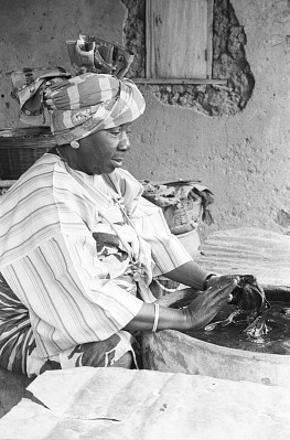 Yoruba woman dyeing fabrics with indigo, Ife, Nigeria, [negative]