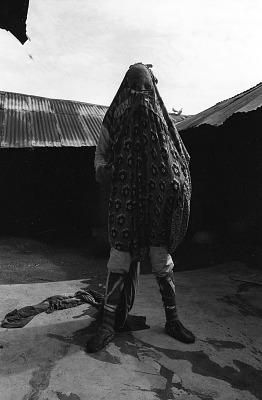 Ancestral masker performing at an Egungun masquerade, Oshogbo, Nigeria, [negative]