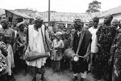 Musicians accompanying Egungun masquerader, Ede, Nigeria, [negative]