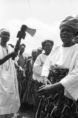 Representative of cult group and woman worshipper attenting a community festival, Ede, Nigeria, [negative]