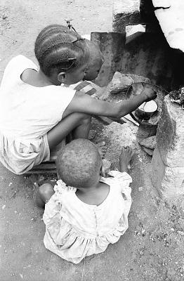 Domestic scenes in front of house of Latifu Awoyale, Ibadan, Nigeria, [negative]
