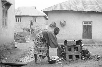Woman preparing meal, Ife, Nigeria, [negative]