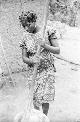 Yoruba woman with hair wrapped in black thread, Ife, Nigeria, [negative]