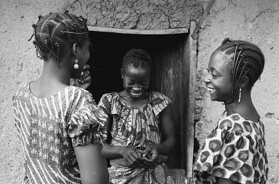 Yoruba women with hair wrapped in black thread, Ife, Nigeria, [negative]