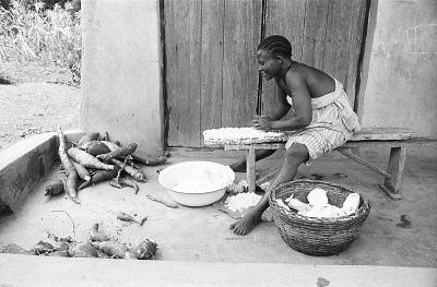 Woman grating tubers, Ife, Nigeria, [negative]