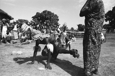 Masked performers wearing pair of male and female Chi wara headdresses, Bougouni village, Mali, [negative]