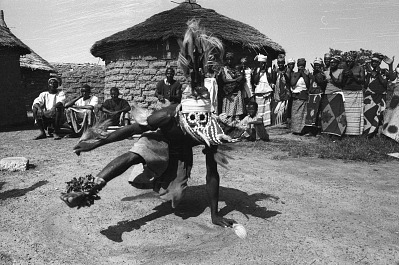 Masked performer wearing vertical Chi wara headdress, Bougouni village, Mali, [negative]