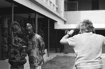 Cameraman George Bracher filming renowned woodcarver Lamidi Olonade Fakeye, Ibadan, Nigeria, [negative]