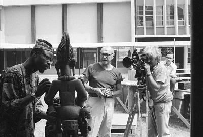 Eliot Elisofon and cameraman George Bracher filming renowned woodcarver Lamidi Olonade Fakeye, Ibadan, Nigeria, [negative]