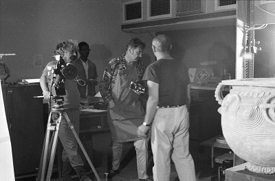 Eliot Elisofon and cameraman George Bracher filming pot found at Igbo-Ukwu excavation site, Ibadan, Nigeria, [negative]