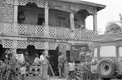 Eliot Elisofon and cameraman George Bracher filming renowned painter Twins Seven Seven, Oshogbo, Nigeria, [negative]
