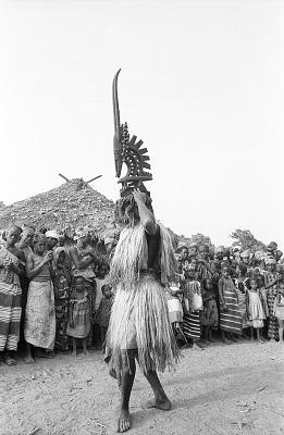 Masked performer wearing male Chi wara headdress, Bamako (national district), Mali, [negative]
