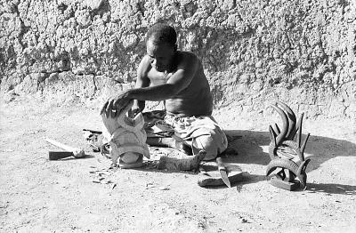 Blacksmith-sculptor producing vertical Chi wara headdress out of a solid mass of wood, Bamako region, Mali, [negative]