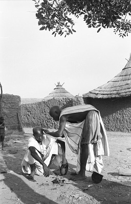 Man getting a shave. Bin village, Mali, [negative]