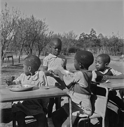 Young Children Eating at Nursery School
