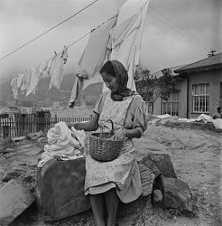 Muslim Woman Doing Laundry