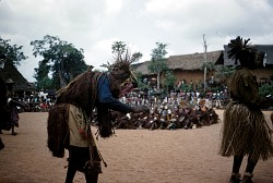 Ori players coming out and dancing at the Okumkpa performance, Mgbom village, Afikpo Village-Group, Nigeria. [slide]
