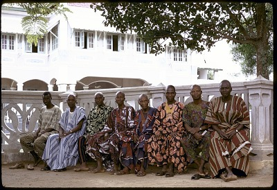Yoruba men sitting outside the Oni's palace, Ife, Nigeria, [slide]