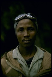 Tanzanian guide with mountain climbing equipment, Mount Kilimanjaro, Tanzania, [slide]