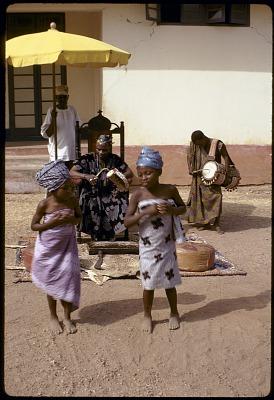 Two girls dancing for John Adetoyese Laoye I, Timi of Ede, Ede, Nigeria, [slide]