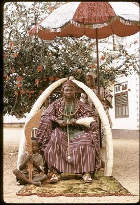 Oba Olateru Olagbegi II, the Olowo of Owo, seated beneath carved ivory tusks, Owo, Nigeria. [slide]