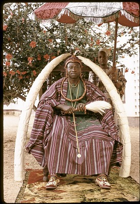 Oba Olateru Olagbegi II, the Olowo of Owo, seated beneath carved ivory tusks, Owo, Nigeria. [slide]