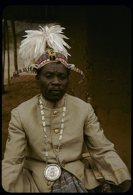 Yaka kyambvu (ruler) Pandzu Pfumukulu wearing traditional bicorn headdress, near Kasongo Lunda, Congo (Democratic Republic). [slide]