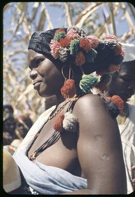 Fulbe woman with brightly tasseled hat, Zaranda village, east of Jos, Nigeria, [slide]