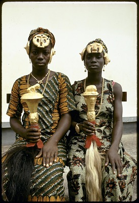 Katherine Ake Agouabe and Franc̦oise Dao Alouette with hair ornaments and fly-whisks adorned with gold leaf, Anna village, Ivory Coast. [slide]